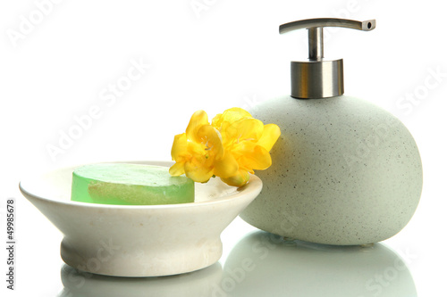 Bottle and soap-dish with soap isolated on white
