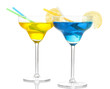 Yellow and blue cocktails in glasses isolated on white