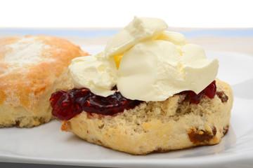 Scone with raspberry jam and cream