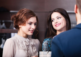 Two wonderful women talk to shop assistant