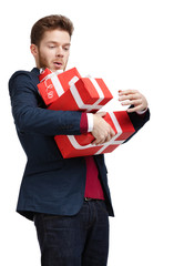 Young man carries a great amount of presents