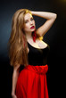 art fashion photo of young woman on dark background