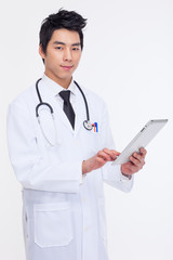 Young Asian doctor using tabet pc