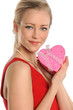 Young Woman Holding Heart Shaped Gift
