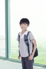 Happy student back a backpack go to  school