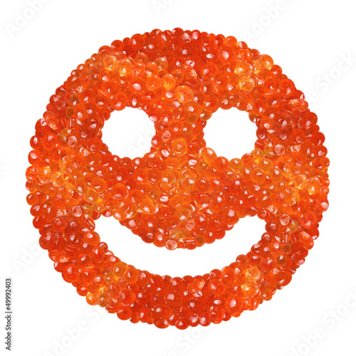 Red caviar in the form of a smile on a white background
