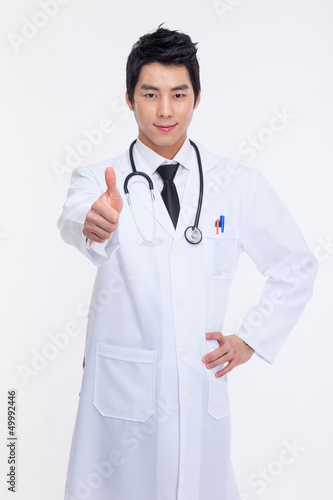 Young Asian doctor showing thumb