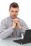 Serious businessman sitting at desk