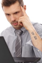 Trendy businessman with tattoo