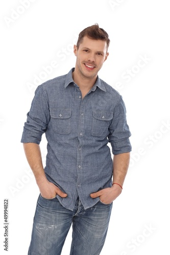 Casual man smiling with hands in pockets