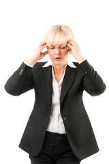 Geschäftsfrau mit Kopfschmerzen oder Burnout