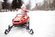 Children are riding on snowmobiles.