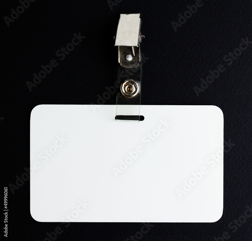 blank white id card on black background