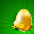 Golden egg with ribbon on green rays background.