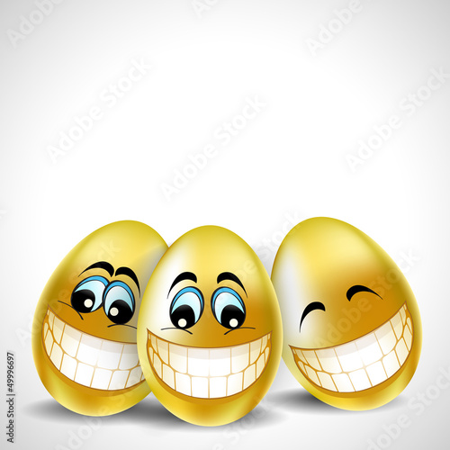 Golden laughing easter eggs on white background for Happy Easter