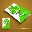 St. Patrick's Day greeting card or flyer with shamrock leaves on