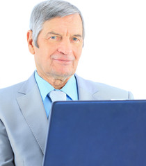 The businessman at the age of works for the laptop.