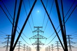 Power lines on blue sky. - 49997673