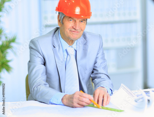 Engineer at the age of considering plans