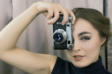 Girl with makeup and retro film camera