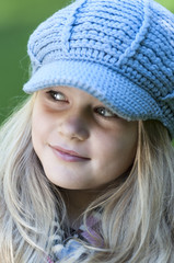 Blond girl with cap