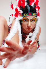 Beautiful young woman native American Indian looking at camera w