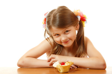 Little girl with appetite for delicious cake
