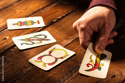 Hand with Four Aces of Neapolitan Cards