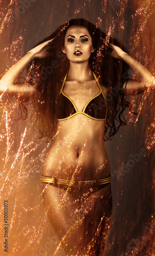 beautiful gold woman in fire