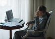 Stressed business woman working in hotel room