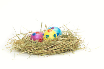 Three colorful Easter Eggs in a nest