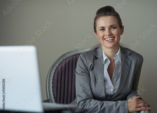 Portrait of smiling business woman in hotel room