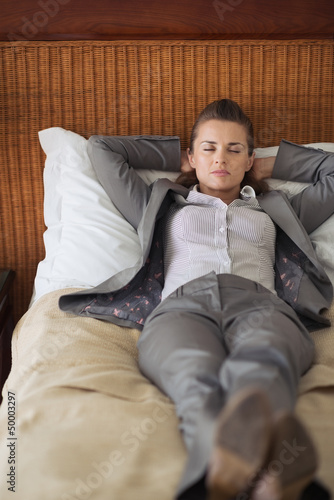 Tired business woman sleeping in hotel room