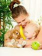 young mother,baby and their pet rabbit