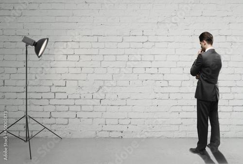 man on brick room