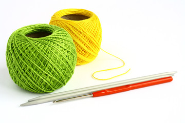 Set for knitting on a white background.