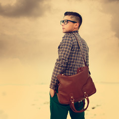 handsome hipster guy with a bag. vintage photo