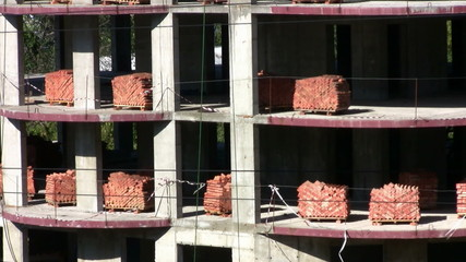 Pallets of bricks at a construction site