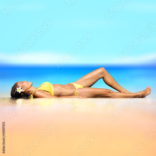 Beach vacation holiday woman in a bikini relaxing