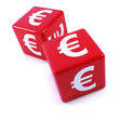 Two red dice with Euro symbol