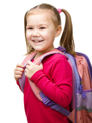 Portrait of a cute little schoolgirl with backpack
