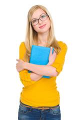 Portrait of happy student girl in glasses hugging book