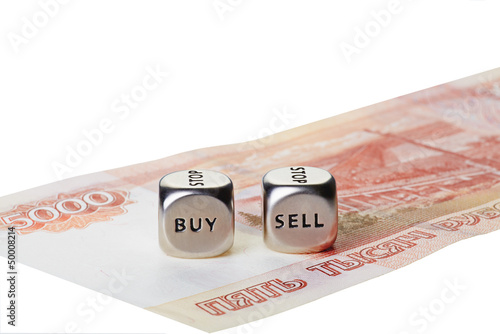 Two metal dices with words Buy and Sell on five thousand rouble