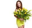 Pretty woman holding a bouquet of tulips