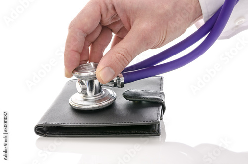 Male hand checking a wallet with stethoscope