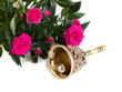 antique bronze bell and bouquet of roses