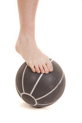 Foot on medicine ball