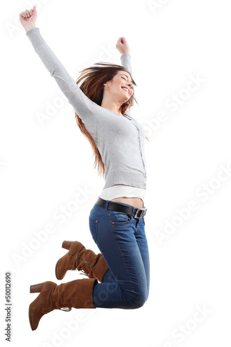 Teenager girl jumping happy