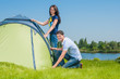 Couple Setting Up Tent
