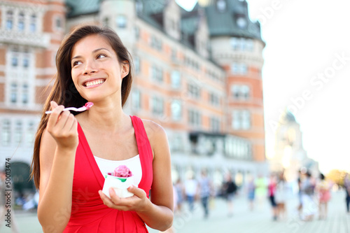 Tourist woman eating ice cream in Quebec City